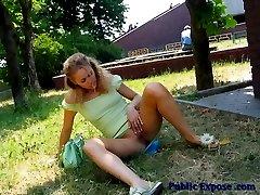 Sexcited blonde slut fingering in public
