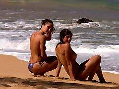 Naked babes enjoy ocean water