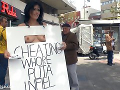 Montse Swinger is a cheating whore of a wife and Mona Wales is there to teach this bitch a lesson! Everyone in town is going to know how many cocks this unfaithful wife has stuffed in her anal hungry ass while Mona parades her fully naked in public where husband's coworkers shop! Who knows how many of these onlookers this Puta has fucked! To continue the humiliation Montse is tied up in rope bondage then fisted and anally fucked in front of a crowd of on duty construction workers!
