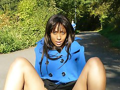 Ebony plays with her pussy in public