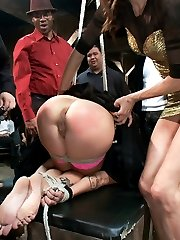 Brandy Aniston gets publicly disgraced for the first time ever and LOVES IT!!! She is tied, and completely covered in a black sheet while the crowd comes in and begins groping her. She has no idea who is touching her or what they will do. Slowly she is unveiled, and the night proceeds with ass fucking, bondage, fisting, squirting, double penetration, strap-on fucking, and more!!!