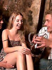 In the wine cellar, this fun loving cutie invites these young studs to live out her wildest fantasy with her. Soon, she has two rock hard dicks inside of her at the same time!