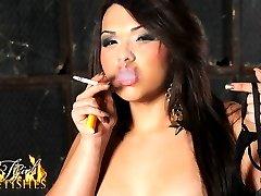 Busty hottie Gia smoking and posing