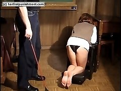 Naked young miss caned on her hands feet and ass - screams of pain