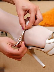 Poor maid sprains her ankle and massages her aching feet thru white tights