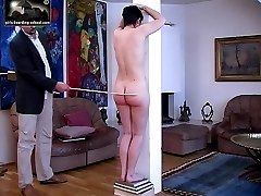 Raven haired beauty's naked caning - well welted cheeks