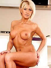 Firm breasted mature blonde Cathie masturbating.