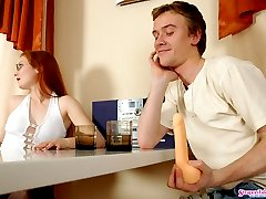 Nasty babe and her neighbor taking time for strap-on fucking right on table