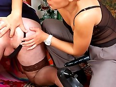 Strap-on armed babe in male suit revealing her tool for hard butt-plowing