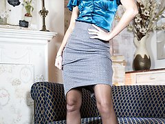 Chloe likes to relax in her vintage nylons after a long day at work, stripping of her satin blouse and tight pencil skirt.