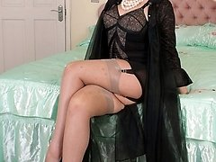 Seductress Shay in frilly, sheer gown, antique corselette and RHT nylons.