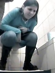 Flicks from spy web cam planted in loo