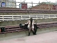 Plump girl masturbates ina public bench beside a active road