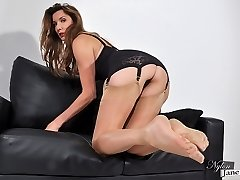 Nylon Jane dressed in lingerie and velvety nylons dangles her high heel boots and smokes in her fetish