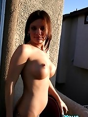Sexy chick posing topless outdoors