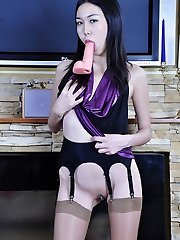 Exotic looking prankster dildo screwing in shiny nylons and pinkish high heels