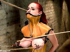 Please welcome Berlin back to Wiredpussy. It has been over a year since the last time she was featured on this site, but it was surely worth the wait. She comes back ready to face an even harder and more challenging shoot than her first one. She gets completely immobilized shocked and caned in a latex corset and neck binder. Then her sight is taken away by the blackout contact lenses, while Princess Donna helps her get over her fear of the cattleprod. Her tits are tied up, and her nipples and clit get some serious suction. Then she must work hard to get fucked as she struggles to reach Donna's cock while her throat is held up by rope. This is an epic Wiredpussy shoot, don't miss it!