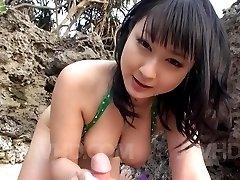 Megumi Haruka Asian busty strokes and licks dong head outdoor