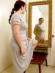 Chubby babe looks in the mirror