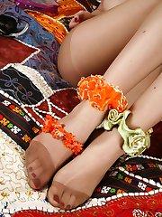 Naughty gal gets fun embellishing her yummy feet encased in sheer pantyhose