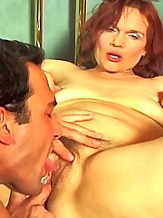 Mature redhead bitch loving a warm wet tongue in her shaggy slit