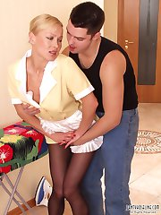 Horny guy spying at upskirt French maid in black tights doing the ironing