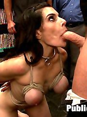 Annika is blinfolded, bound, and lead into a porn store where she is molested by horny dudes, Princess Donna, and Mark Davis. She sucks cock through a glory hole, gets ass fucked, and has a dildo gag strapped to her face to make the Princess cum.