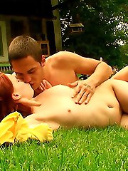 Out in the backyard, this redhead nympho lets her lover explore all of her body. He uses his hands, his mouth and of course his rock hard cock to explore her tender body.