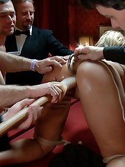 Mellanie Monroe gets tied up and made to entertain for an armory soiree. This red-hot blonde hastily learns that amusing the guests of this fine establishment is no easy task, as her booty gets without mercy flogged, her fuckholes get filled, and her face gets caked in jizz.