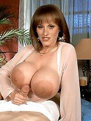 Big dick in between huge luscious tits