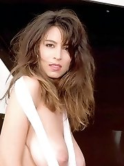 Christy Canyon stripping lingerie showing all