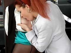 Horny milf giving a girl intimate pussy massage and lesbian kisses at work