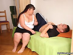 He hurts his back and the chubby mature babe helps him feel better by giving her pussy