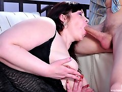 Stacked mature fatty feeds her ripe melons to a boy and gets pussy fisted