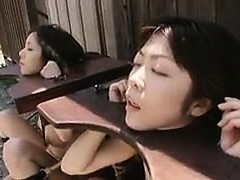 Helpless Oriental dolls getting their faceholes stuffed with