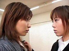Two japanese business women exchange and gulp cum