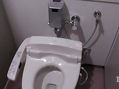 Elitist deviating woman. In the restroom in a workplace, onan