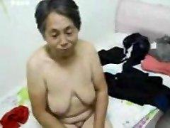 Asian Grandma get dressed after romp