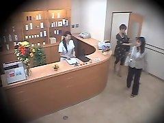 Two cute Asians screwed rock hard in voyeur massage vid
