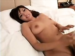Stunning Asian girl with handsome huge boobs gives a sensua