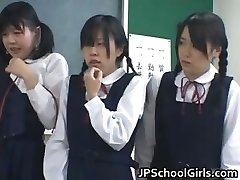 Asian schoolgirls in the classroom are partTwo
