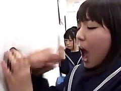 Japanese school girl deep-throating cock through gloryhole in class