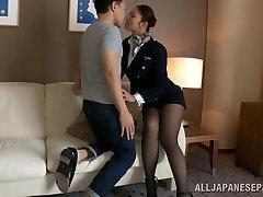 Hot stewardess is an Asian lady in high heels