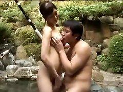 Breasty biotch fucking an Asian boy in a pool