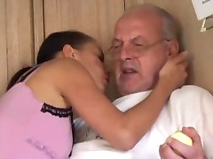 Young brunette licks grandpa all over and fucks him