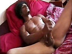 Black man rubbin' his own cock