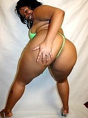 Ebony plumper rubbing her clit while bouncing on top of a horny black guy and gets nasty facial