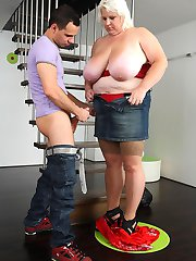 He bends the BBW beauty over on the stairs and inserts his dick into her from behind