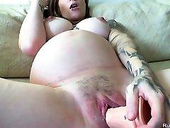 Pregnant brunette sex-positive strokes with huge dildo