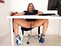 Chubby English sex addict Ashley Rider fondles her meaty cooter in the office